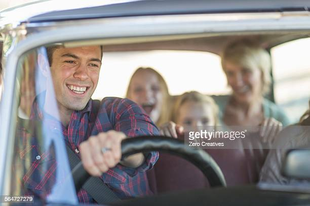 Family in car together, taking road trip