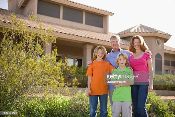 Family in front of house, Arizona