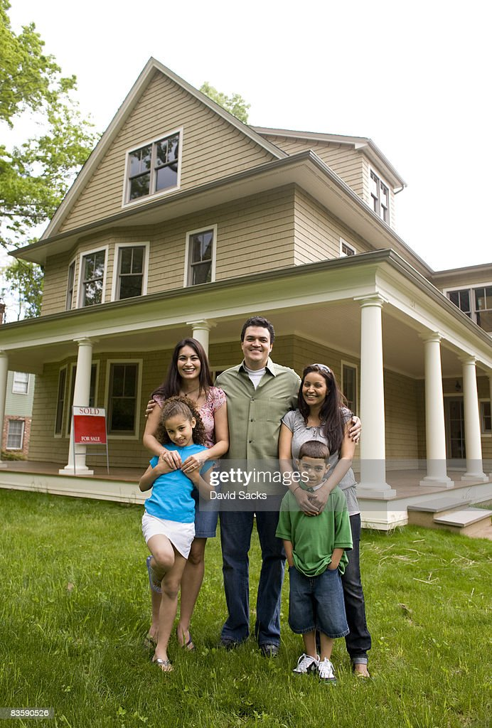 Family in front of new house : Stock Photo