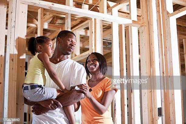 Family in house under construction