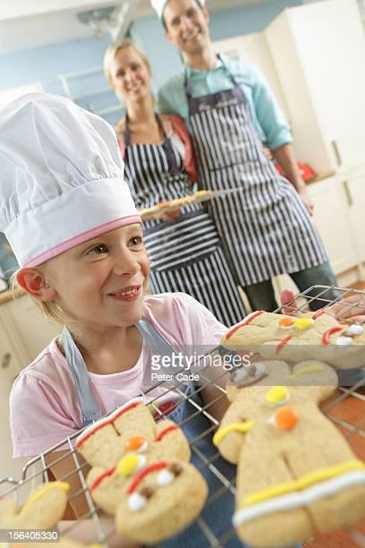 Family in kitchen baking gingerbread men
