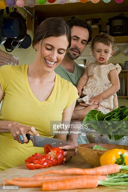 Family in kitchen with vegetables