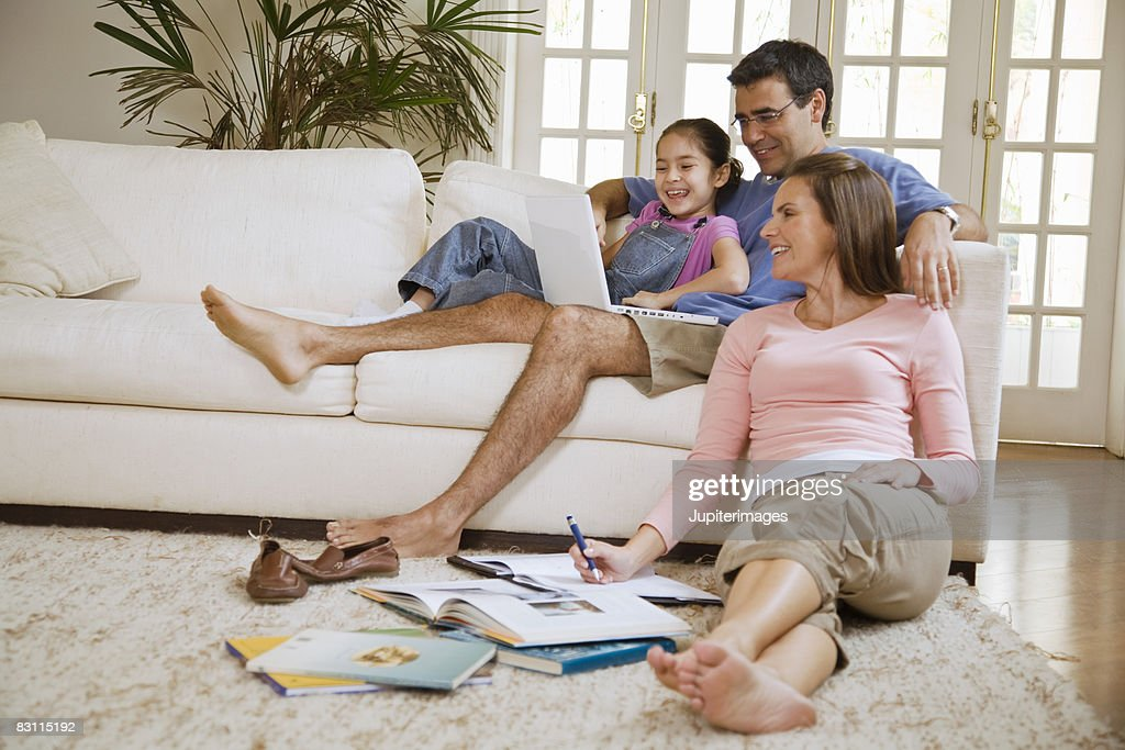 Family In Living Room Stock Photo Thinkstock