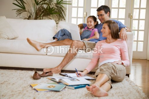 Family In Living Room Stock Photo | Thinkstock