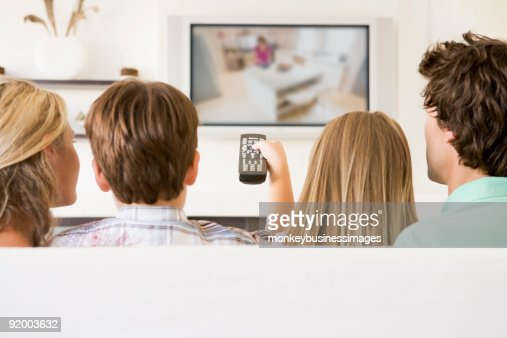 Family in living room watching TV : Stock Photo