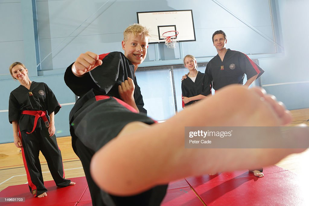 Family in sports hall doing tae kwon do : Stock Photo