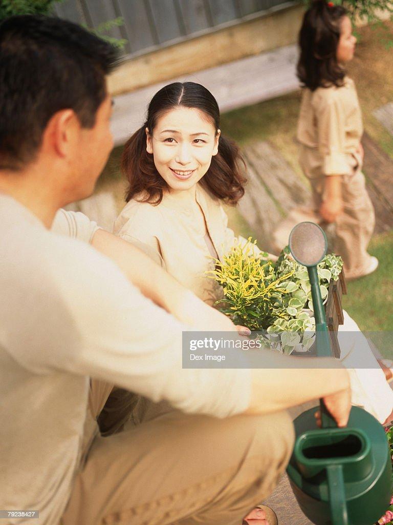 Family in the garden : Stock Photo