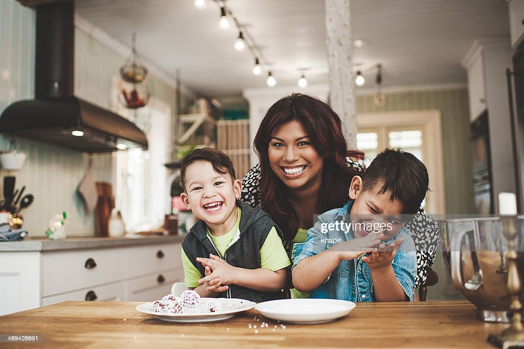 Family in the kitchen baking : Stock Photo