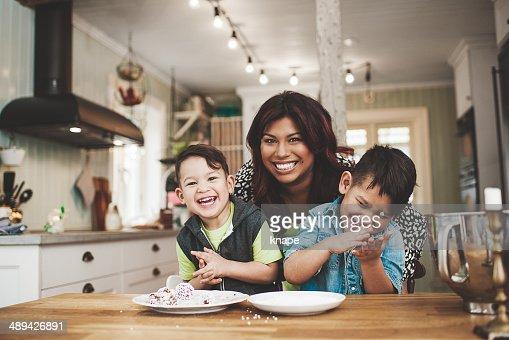 Family in the kitchen baking : Stock Photo