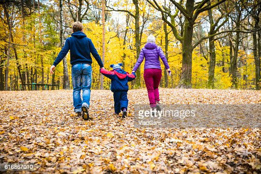 Family in the park in autumn day : Stock Photo