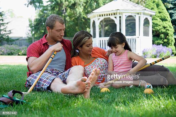 Family in yard with croquet set