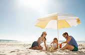 Shot of a happy young family playing together on the beachhttp://195.154.178.81/DATA/i_collage/pu/shoots/784349.jpg