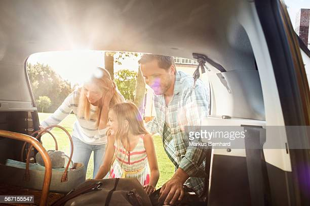 Family is packing car
