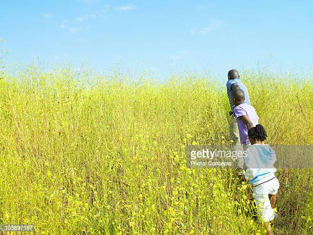 A family is running through a field