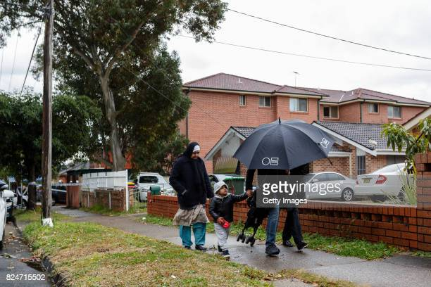 A family is scene leaving an apartment complex in Sproule Street Lakemba on July 31 2017 in Sydney Australia Counter terrorism police raided four...