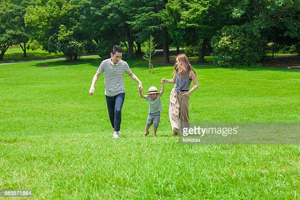 Family is walking happily in the park