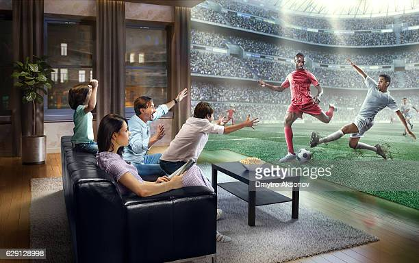 Family is watching Soccer game at home