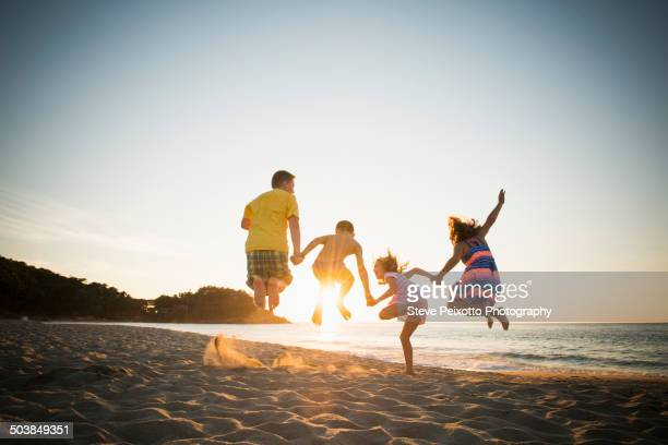 Family jumping for joy on beach