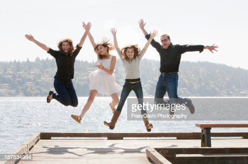 family jumping for joy stock photo getty images