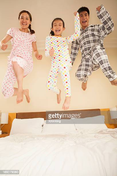 Family Jumping on Bed Together