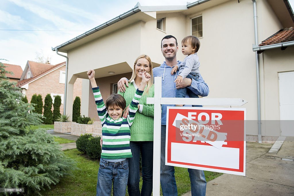 Family just buy a hew home : Stock Photo