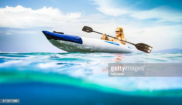 Family kayaking on sea, water level view
