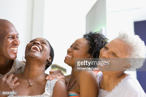 Family laughing at home : Stock Photo
