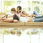 Family laughing on couch