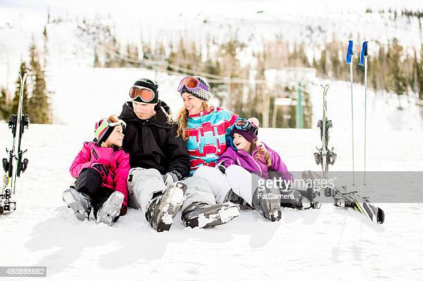 Family Laughing Together on the Mountain