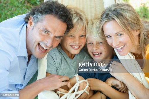 Family laughing together, portrait : Stock Photo