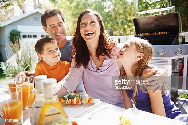 Family laughter in the sun