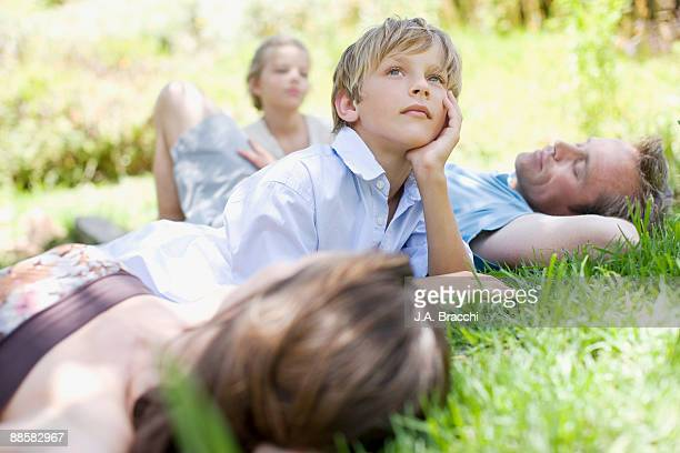 Family laying in grass