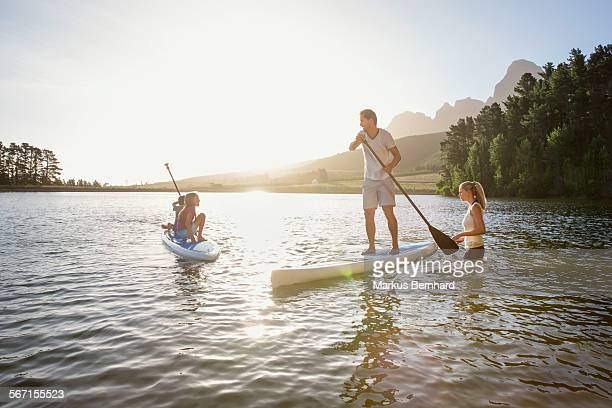 Family learns stand-up paddling