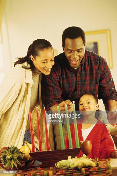Family lighting the Kinara for Kwanzaa
