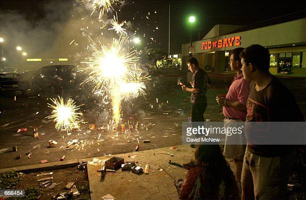 A family lights fireworks to celebrate the Fourth of July in Santa Ana CA where personal fireworks are legal