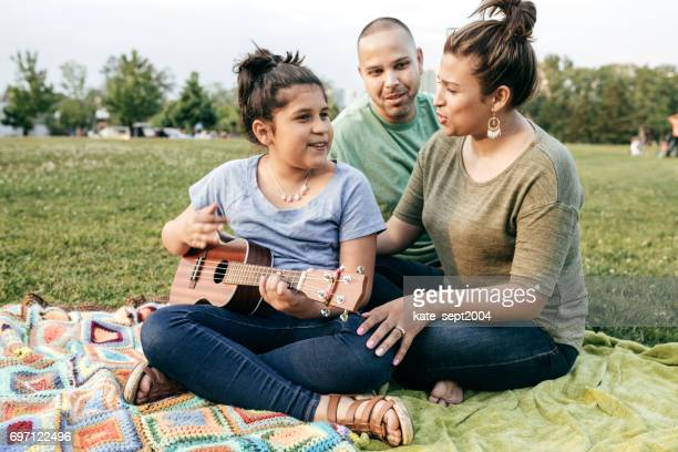 Family listening daughter's song