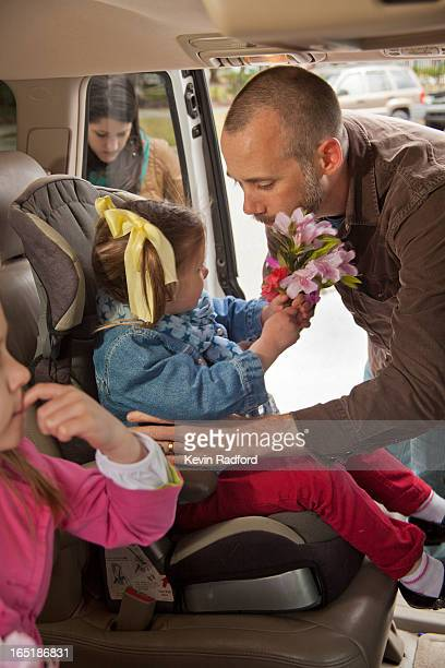 Family loading kids into automobile (van)