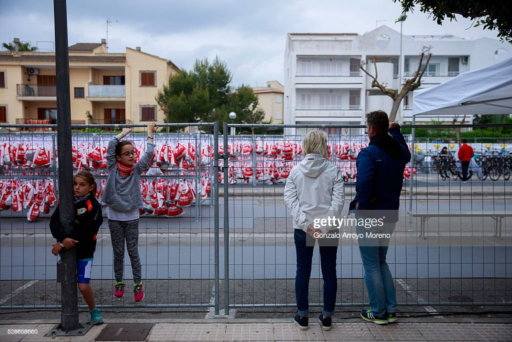 A family look the transition area above its fence the day before Ironman 70.3 Mallorca on May 6, 2016 in Alcudia, at Palma de Mallorca island, Spain.