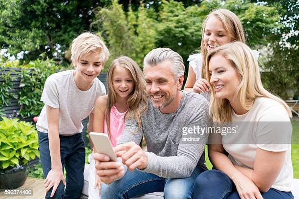 Family looking at a selfie