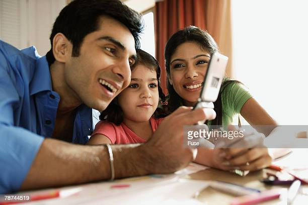 Family Looking at Cell Phone