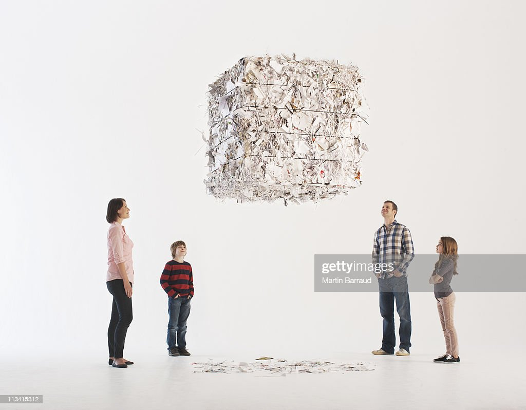 Family looking at floating paper bale