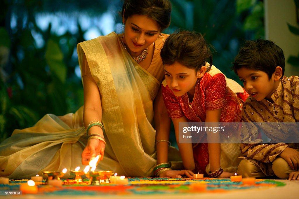 Family Looking at <Kolam>, or <Rangoli> Drawings