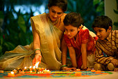 Family Looking at <Kolam>, or <Rangoli> Drawings