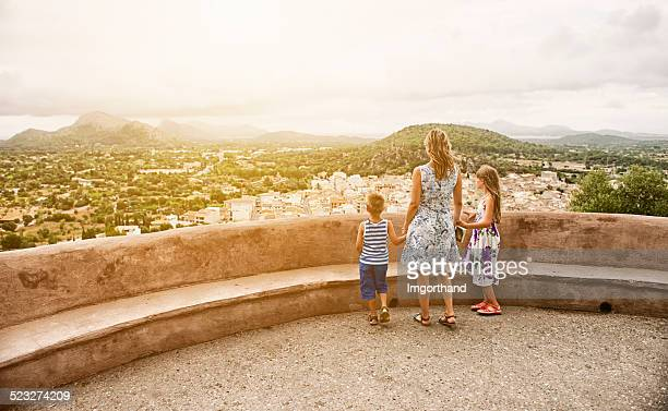 Family looking at mediterranean town of Pollenca, Mallorca.