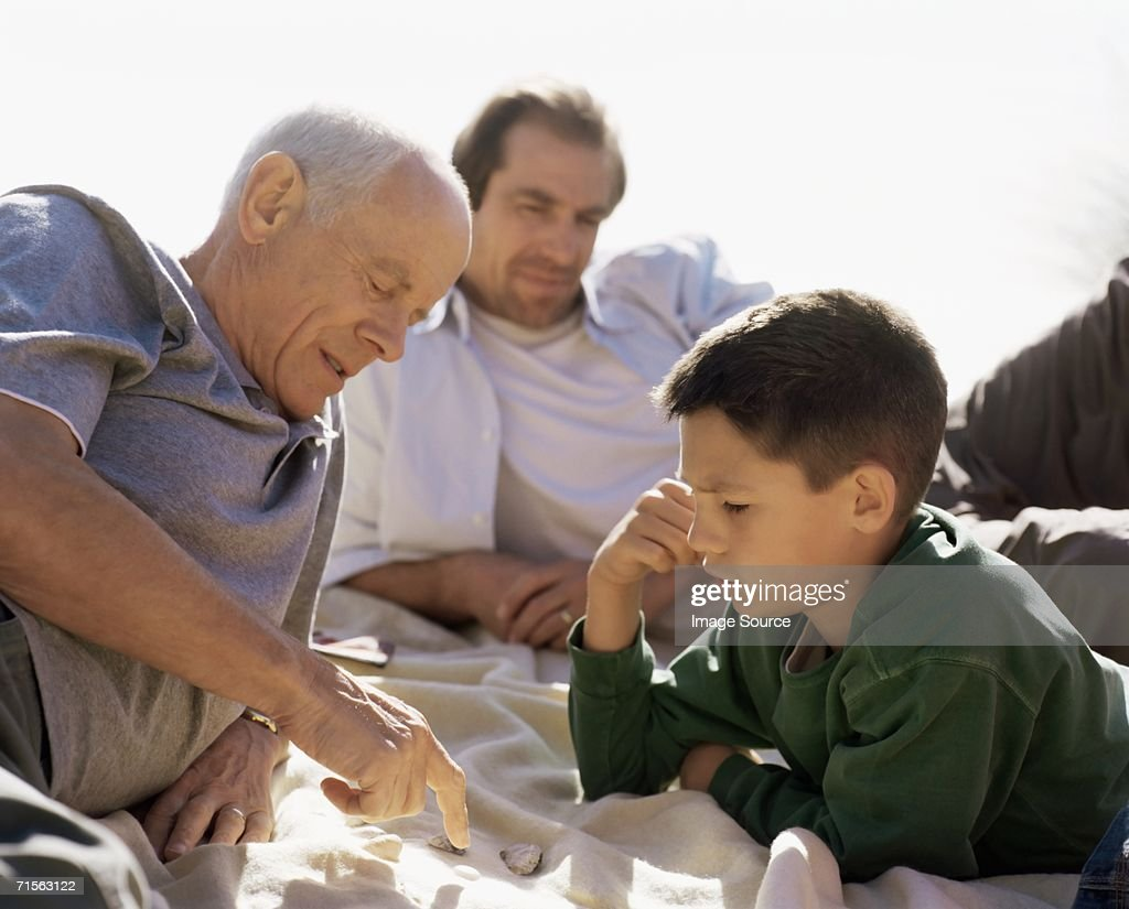Family looking at shells : Stock Photo