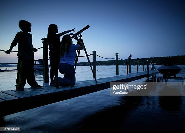 family looking at the strars from a jetty