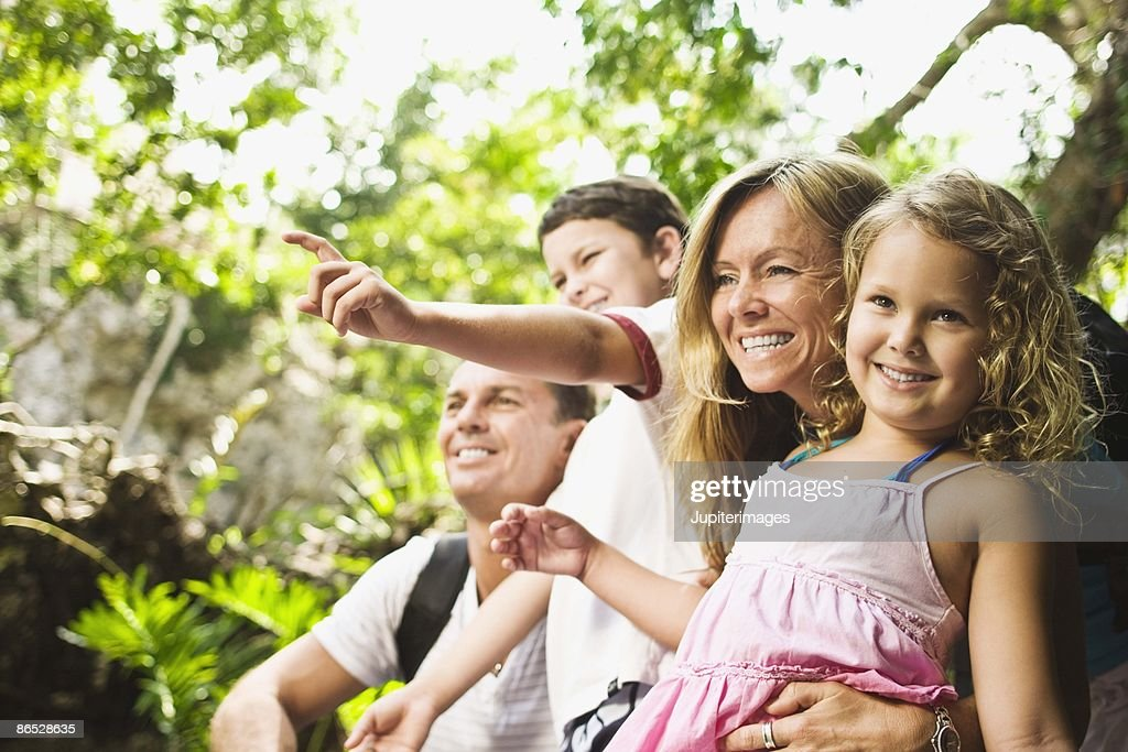 Family looking in the forest : Stock Photo