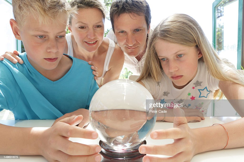 family looking into crystal ball : Stock Photo