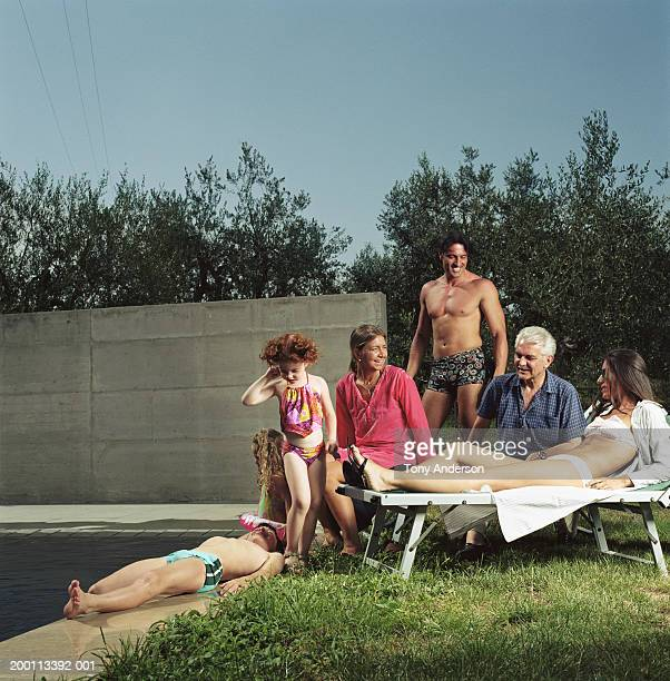 Family lounging near swimming pool