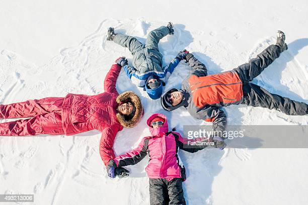 Family Lying in a Circle in the Snow